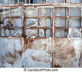 Abandoned rusty metal door