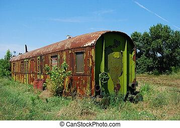 Abandoned rusty railway wagon