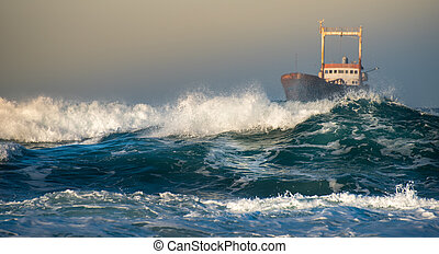 Abandoned ship in the stormy ocean with big wind waves during sunset.
