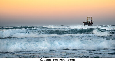 Abandoned ship in the stormy sea