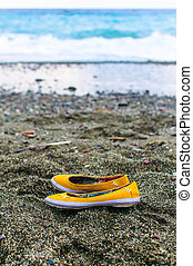 abandoned shoes on the beach