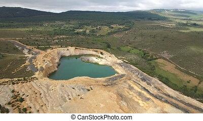 Abandoned slate mine hole - Aerial view of abandoned slate...