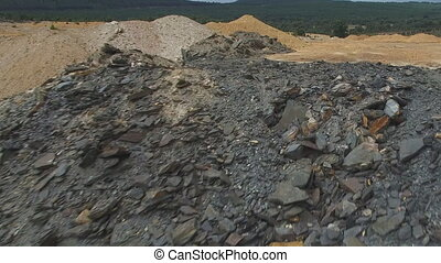 Abandoned slate mine rubble - Sliding camera over abandoned...