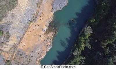 Abandoned slate mine with water hole, top view - Aerial view...
