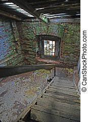Abandoned store house hall with a staircase.