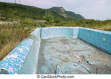 Abandoned swimming pool with mountain background