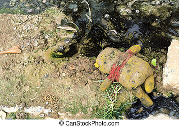 Abandoned Toy Doll In The Mud