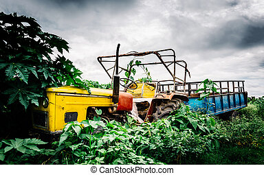 Abandoned tractor with trailer - Abandoned vintage yellow...