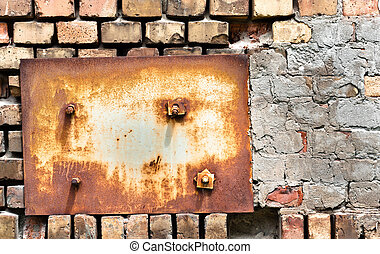 Abandoned wall texture with metal plate