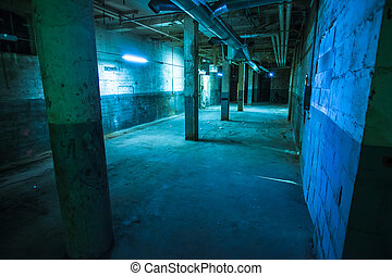 Abandoned warehouse lit blue - Dark empty older warehouse /...