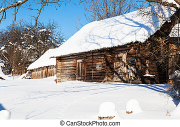abandoned wooden russian rural house in winter