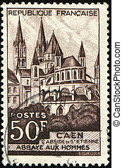 Abbaye-aux-Hommes - FRANCE - CIRCA 1951: A stamp printed in...