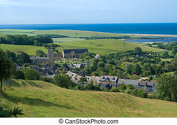 Looking down on the picturesque village of Abbotsbury, Dorstet England, with Chesil beach in the background