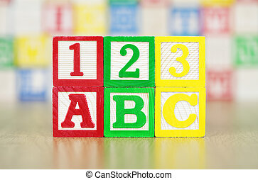 ABC and 123 Spelled Out in Alphabet Building Blocks