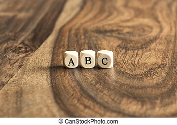 ABC blocks on wooden background