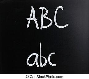 """ABC"" handwritten with white chalk on a blackboard"