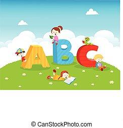 ABC Kids - Cute little kids reading book near abc.