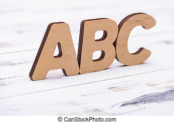 ABC letters on white wooden background. Education concept. Free copy space.