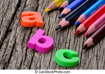 Abc word with colorful pencils on table - Abc word with...