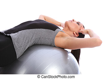 Abdominal crunches by fit woman on exercise ball