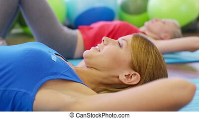 Energetic young woman doing abdominal crunches in the gym