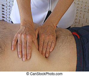Abdominal examination - Female therapist performing...