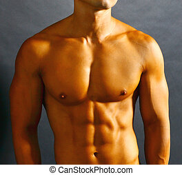 Abdominal Muscles - Athletic shirtless male with tanned skin...