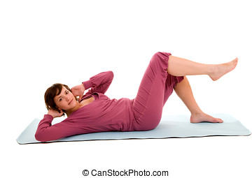 Abdominals - Pretty brunette doing abdominal exercises on a...