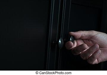 abertura, gabinete, roupas, botão, closeup, porta, mão, pretas, metálico
