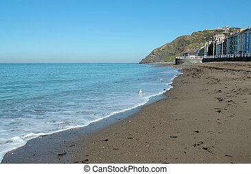 Aberystwyth North beach calm sea.