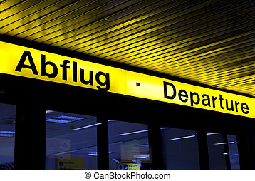 yellow illuminated sign of abflug departure at an airport