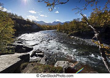 Abiskojokk. River in autumn in Abisko National Park, Sweden