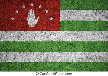 Abkhazia flag painted on the cracked grunge concrete wall