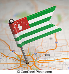 Abkhazia Small Flag on a Map Background.
