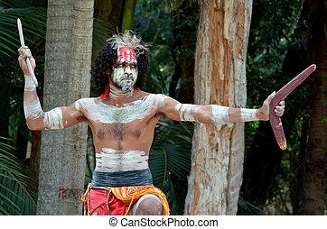 Portrait of one Yugambeh Aboriginal warrior man preform Aboriginal culture martial art during cultural show in Queensland, Australia.