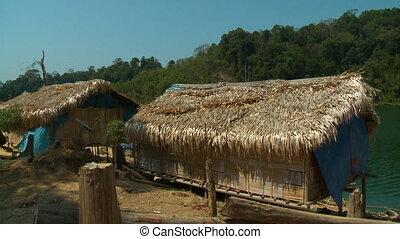 Aboriginal Straw Huts| Lake Temenggor, Malaysia - Medium low...