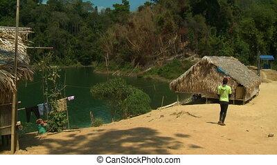 Aboriginal Teenage Boy At A Village Home, Malaysia - Wide...
