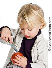 About to be cut - Young girl playing a dangerous game with a...