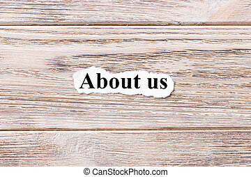About us of the word on paper. concept. Words of About us on a wooden background