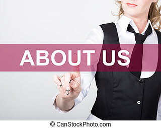 about us written on virtual screen. technology, internet and networking concept. woman in a black business shirt presses button on virtual screens