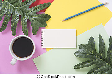 above blank to do list notebook with leaf and coffee cup on color design background.