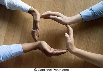 Above closeup view businesspeople hands in shape of circle