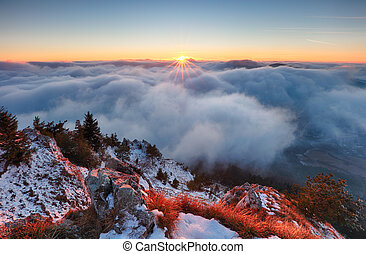 Above clouds in winter - mountain landcape at sunset, Slovakia