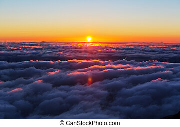 Above clouds - Beautiful sunset on the hill above clouds