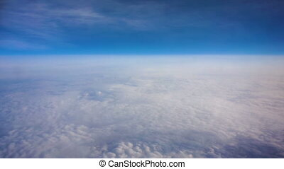 Above clouds, view from pilot cabine airplane. Blue sky,...
