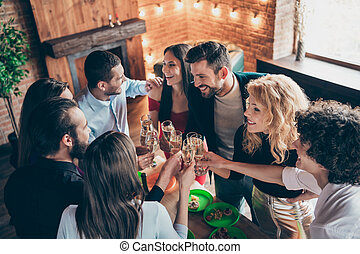 Above high angle view of nice attractive lovely elegant cheerful cheery glad friendly guys meeting spending romantic evening together congrats at modern industrial brick wood loft style interior house