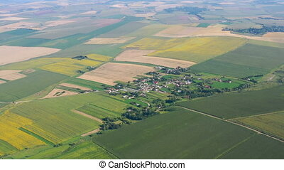 Above summer rural landscape, aerial view of village and ...
