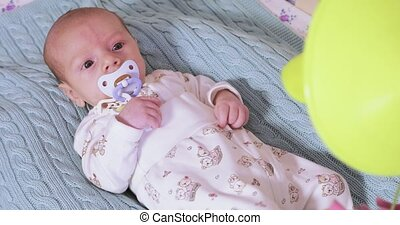 Classic Developmental Baby Mobile - Above the baby's bed the...