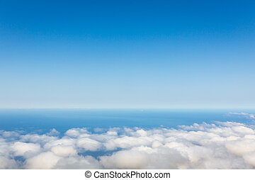 Above the clouds - Aerial view of clear sky above the clouds...