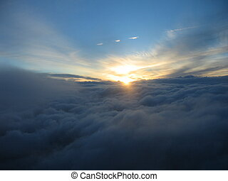 Above the clouds - a sunset seen form 30000 feet above a...